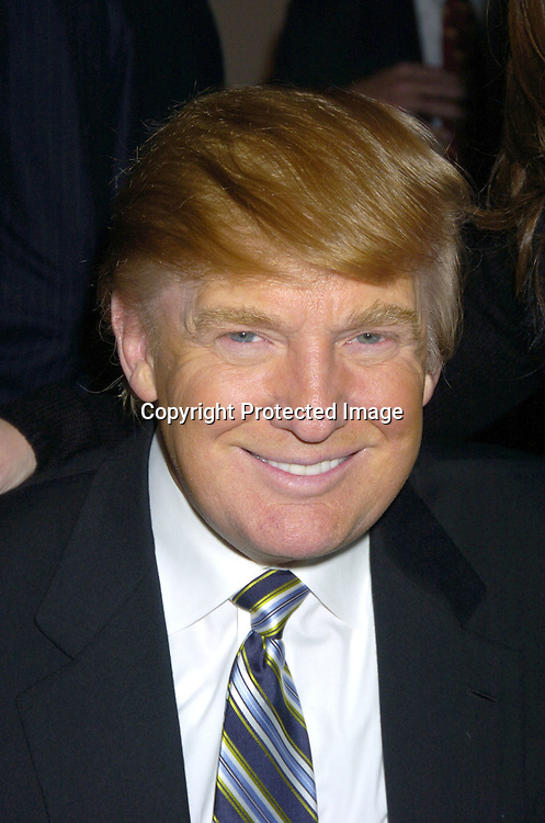 Donald Trump ..at the NYC and Company dinner honoring leaders in ..Tourism:  including American Express's Ken Chenault, ..NBC Universal's Bob Wright, Nicole Miller and Joseph Spinnato  on December 13, 2004 at the Museum of Modern ..Art. ..Photo by Robin Platzer, Twin Images