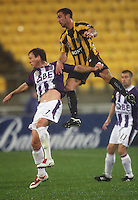 Phoenix' Manny Muscat rises above Todd Howarth during the A-League football match between Wellington Phoenix and Perth Glory at Westpac Stadium, Wellington, New Zealand on Sunday, 16 August 2009. Photo: Dave Lintott / lintottphoto.co.nz