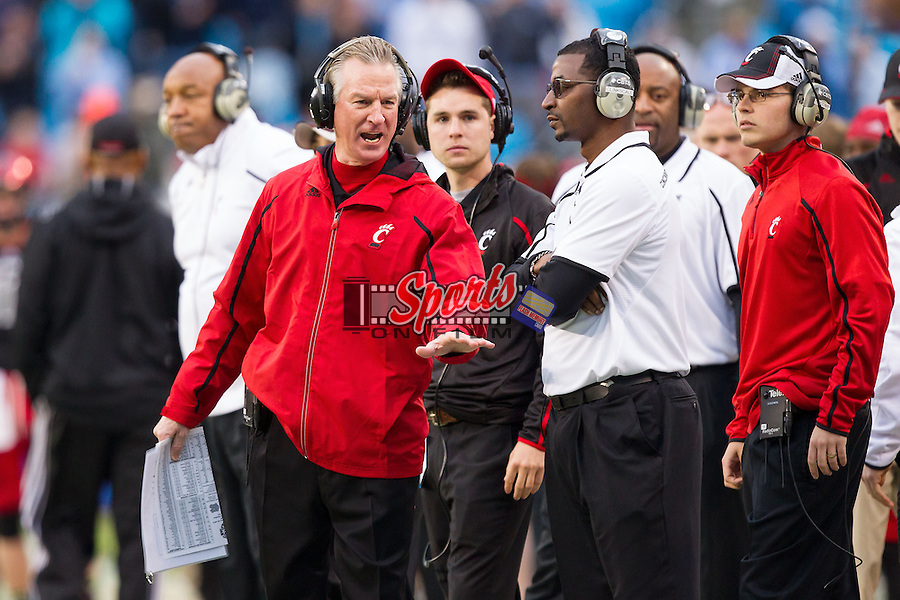 Cincinnati Bearcats head coach Tommy Tuberville yells at an assistant coach during the Belk Bowl against the North Carolina Tar Heels at Bank of America Stadium on December 28, 2013 in Charlotte, North Carolina.  The Tar Heels defeated the Bearcats 39-17.   (Brian Westerholt/Sports On Film)