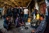 People gambling on a back street in Old Lhasa, Tibet (Xizang), China.