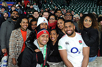 Joe Cokanasiga of England poses for a photo with family after the match. Quilter International match between England and Australia on November 24, 2018 at Twickenham Stadium in London, England. Photo by: Patrick Khachfe / Onside Images