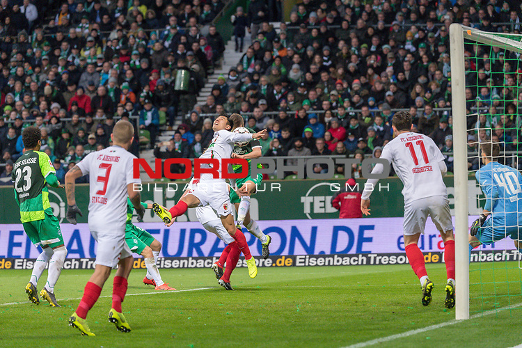 10.02.2019, Weser Stadion, Bremen, GER, 1.FBL, Werder Bremen vs FC Augsburg, <br /> <br /> DFL REGULATIONS PROHIBIT ANY USE OF PHOTOGRAPHS AS IMAGE SEQUENCES AND/OR QUASI-VIDEO.<br /> <br />  im Bild<br /> <br /> kopfball Niklas Moisander (Werder Bremen #18) an den Arm von Dong-Won Ji (FC Augsburg #22)<br /> <br /> Foto © nordphoto / Kokenge