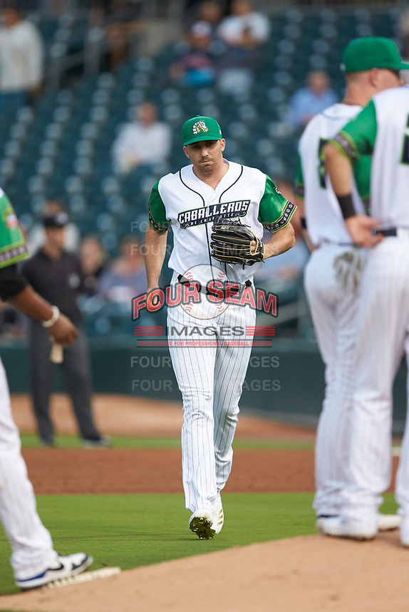 Caballeros de Charlotte relief pitcher Zach Thompson (32) jogs in from the bullpen during the game against the Buffalo Bisons at BB&T BallPark on July 23, 2019 in Charlotte, North Carolina. The Bisons defeated the Caballeros 8-1. (Brian Westerholt/Four Seam Images)