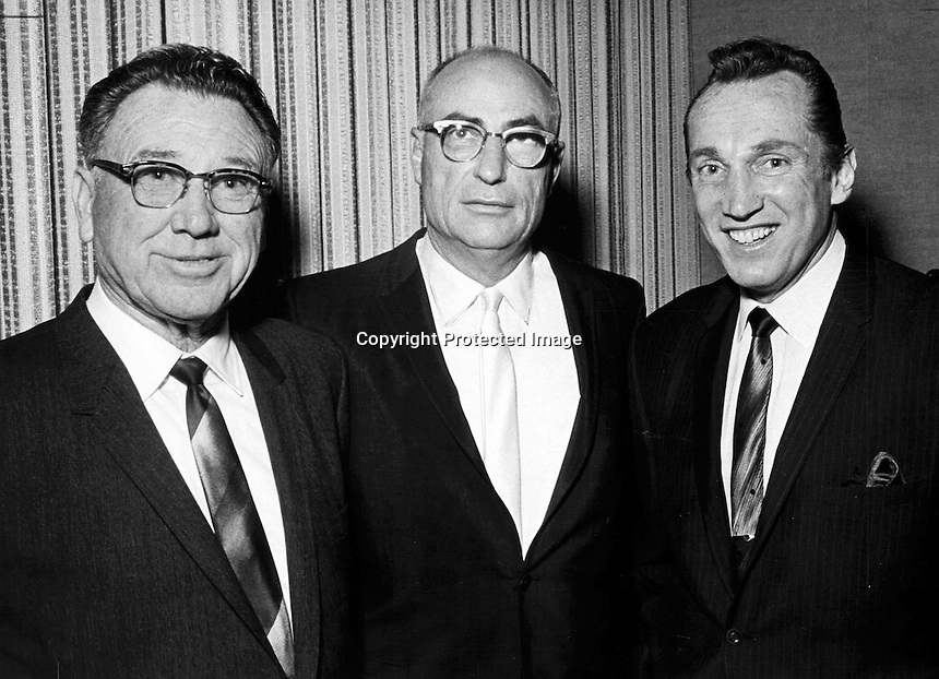 Raider owners, Ed McGah, Wayne Valley and Al Davis..photo by Ron Riesterer