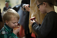 NWA Democrat-Gazette/CHARLIE KAIJO Coleman Weatherford, 3 and Aidan Weatherford, 6, of Bentonville (from left) eat cupcakes during a cupcake fundraiser, Sunday, February 10, 2019 at the First United Methodist Church in Bentonville. <br />