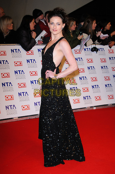 Lara Pulver.arrivals at The National Television Awards, O2 Greenwich, London, England. 25th January 2012.NTA NTAS full length black dress hand on hip sparkly beads beaded side sleeveless.CAP/CJ.©Chris Joseph/Capital Pictures.