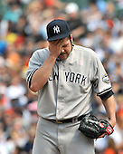 Baltimore, MD - May 10, 2009 -- New York Yankees pitcher Joba Chamberlain (62) wipes his brow as he pitches in the third inning against the Baltimore Orioles at Oriole Park at Camden Yards in Baltimore, MD on Sunday, May 10, 2009..Credit: Ron Sachs / CNP.(RESTRICTION: NO New York or New Jersey Newspapers or newspapers within a 75 mile radius of New York City)