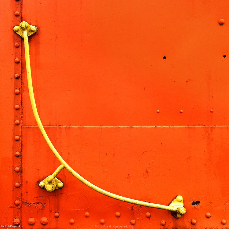 iPhone photography by Larry Kasperek. A handrail on a vintage railroad car.