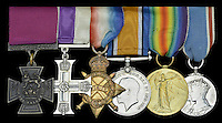 BNPS.co.uk (01202 558833)<br /> Pic: DixNoonanWebb/BNPS<br /> <br /> The decorations and medals awarded to George Sanders. From left to right: Victoria Cross, Military Cross, 1914-15 Star, British War Medal, Victory Medal, George VI Coronation Medal.<br /> <br /> A Victoria Cross awarded to a hero British soldier on the first day of the Somme is being sold by his family for &pound;220,000 over 100 years later.<br /> <br /> Corporal George Sanders led a band of 30 men in repelling repeated German attacks over two days after a communications break down left them cut off in an enemy trench.<br /> <br /> For nearly two days without any food or water, he drove off a raid by the enemy which required hand-to-hand combat using bayonets and then stood firm against two strong bombing attacks.<br /> <br /> His Victoria Cross and Military Cross have been passed down through the family and are now to be sold for the very first time at London auctioneers Dix Noonan Webb.