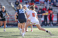 College Park, MD - April 27, 2019: Maryland Terrapins attack Kali Hartshorn (16) scores a goal during the game between John Hopkins and Maryland at  Capital One Field at Maryland Stadium in College Park, MD.  (Photo by Elliott Brown/Media Images International)