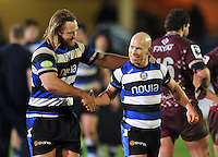 Ross Batty shakes hands with Peter Stringer after his 101st European Rugby appearance. Amlin Challenge Cup match, between Bath Rugby and Bordeaux-Begles on January 16, 2014 at the Recreation Ground in Bath, England. Photo by: Patrick Khachfe / Onside Images