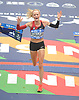 Shalane Flanagan reacts as she crosses the finish line in Central Park to win the women's competition in the TCS New York City Marathon on Sunday, Nov. 5, 2017. She posted a time of 2:26.53 and became the first American born female in 40 years to claim a victory in the city's race.