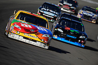 Mar. 1, 2009; Las Vegas, NV, USA; NASCAR Sprint Cup Series driver Kyle Busch leads teammate Denny Hamlin during the Shelby 427 at Las Vegas Motor Speedway. Mandatory Credit: Mark J. Rebilas-