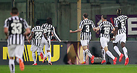 Calcio, ritorno degli ottavi di finale di Europa League: Fiorentina vs Juventus. Firenze, stadio Artemio Franchi, 20 marzo 2014. <br /> Juventus midfielder Andrea Pirlo, third from left, celebrates with teammates after scoring the winning goal on a free kick during the Europa League round of 16 second leg football match between Fiorentina and Juventus at Florence's Artemio Franchi stadium, 20 March 2014. Juventus won 1-0 to advance to the quarter-finals.<br /> UPDATE IMAGES PRESS/Isabella Bonotto