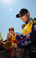 Apr 25, 2009; Talladega, AL, USA; NASCAR Sprint Cup Series driver Jamie McMurray signs autographs during qualifying for the Aarons 499 at Talladega Superspeedway. Mandatory Credit: Mark J. Rebilas-