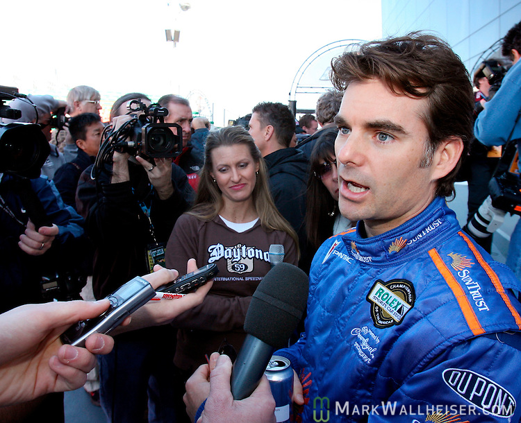 NASCAR driver Jeff Gordon, right, is interviewed in Victory Lane at Daytona International Speedway in Daytona, Florida Friday January 26, 2007 prior to the final practice of the Rolex 24 at Daytona in which he is driving for the SunTrust Racing team in the 24 hour long Grand Am road race.  (Mark Wallheiser/TallahasseeStock.com)