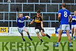 David Shaw Dr Crokes  gets his pass away under pressure from Kieran O'Neill Templenoe during their  SFC clash in Fitzgerald Stadium on Friday evening
