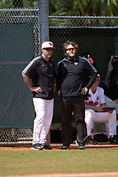 Illinois State Redbirds head coach Bo Durkac (left) and athletic trainer Andrew Benning during a game against the Michigan State Spartans on March 8, 2016 at North Charlotte Regional Park in Port Charlotte, Florida.  Michigan State defeated Illinois State 15-0.  (Mike Janes/Four Seam Images)