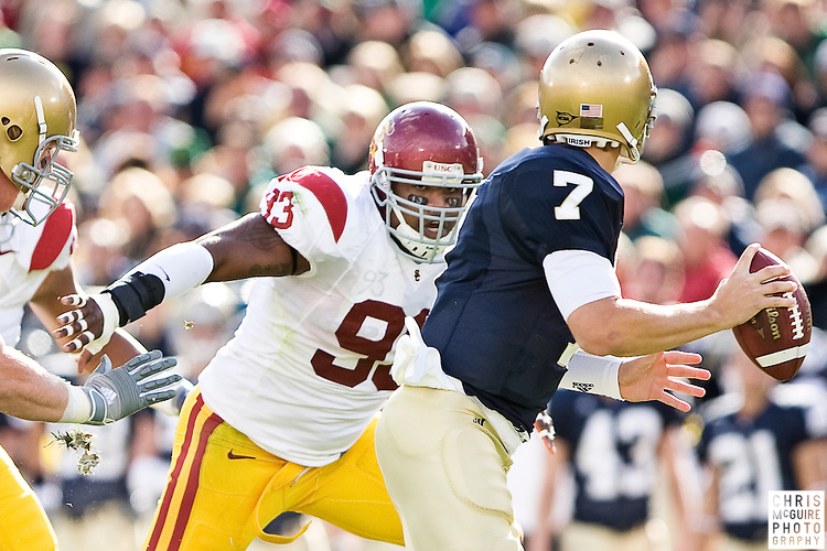 10/17/09 - South Bend, IN:  USC defensive end Everson Griffen closes in on Notre Dame quarterback Jimmy Clausen during their game at Notre Dame Stadium on Saturday.  Griffen had 2 sacks on the day.  USC won the game 34-27 to extend its win streak over Notre Dame to 8 games.  Photo by Christopher McGuire.