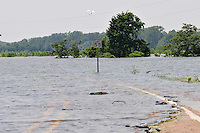 8/12/11} Vicksburg} -- Vicksburg, MS, U.S.A. -- Highway 465 in Vicksburg is washed out by the rising Mississippi River. Members of The Corp of Engineering and Col. Eckstein hold a press conference on the Yazoo backwater levee, detailing how they are trying to contain the flood water from the Mississippi River from flooding over 1.2 million acres of farm land and damaging thousands of homes and disrupting thousands of people. Vicksburg a riverfront town steeped in war and sacrifice, gets set to battle an age-old companion: the Mississippi River. The city that fell to Ulysses S. Grant and the Union Army after a painful siege in 1863 is marshalling a modern flood-control arsenal to keep the swollen Mississippi from overwhelming its defenses. PHOTO©SUZIALTMAN.COM.Photo by Suzi Altman, Freelance.