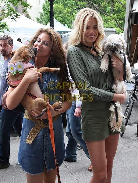 NEW YORK, NY - MAY 14:  Dylan Lauren and model Hailey Clauson, 2016 Sports Illustrated Swimsuit issue cover girl,  at the Dylan's Candy BarN Dog Adoption Event in New York, New York on May 14, 2016.  <br /> CAP/MPI/RMP<br /> &copy;RMP/MPI/Capital Pictures