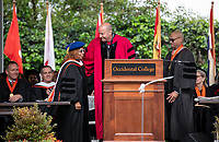 Conferring of Honorary Degree and Response - Jonathan Veitch, President, Lula Bailey Ballton<br /> CEO Emeritus, West Angeles Community Development Corporation and Carl Ballton '69, Trustee.<br /> Families, friends, faculty, staff and distinguished guests celebrate the class of 2019 during Occidental College's 137th Commencement ceremony on Sunday, May 19, 2019 in the Remsen Bird Hillside Theater.<br /> (Photo by Marc Campos, Occidental College Photographer)