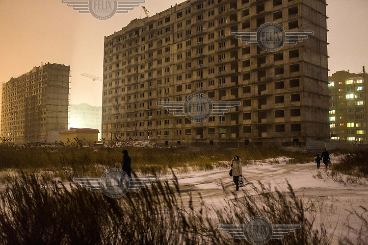 Huge apartment blocks rise on the outskirts of Astana. With thousands of migrants arriving in the city every month from other parts of the Kazakstan, and from other central Asian countries, the capital has seen a massive construction boom with highrises appearing all over the city.