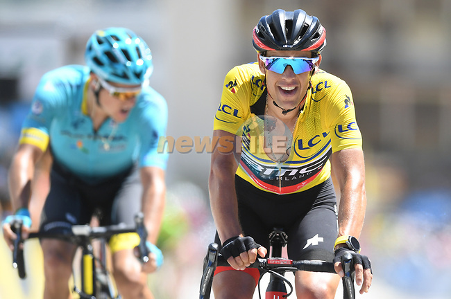 Race leader Yellow Jersey Richie Porte (AUS) BMC Racing Team crosses the finish line on Alpe d'Huez at the end of Stage 7 of the Criterium du Dauphine 2017, running 168km from Aoste to Alpe d'Huez, France. 10th June 2017. <br /> Picture: ASO/A.Broadway | Cyclefile<br /> <br /> <br /> All photos usage must carry mandatory copyright credit (&copy; Cyclefile | ASO/A.Broadway)