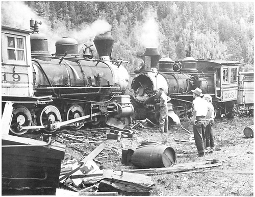 Wreck from movie &quot;Denver &amp; Rio Grande&quot; filmed at Tall Timber resort, Elk Park, CO.  Engines 268 and 319 facing each other.  Several observers standing next to engines.<br /> D&amp;RGW  Elk Park, CO  Taken by Sealy, - ca 1950