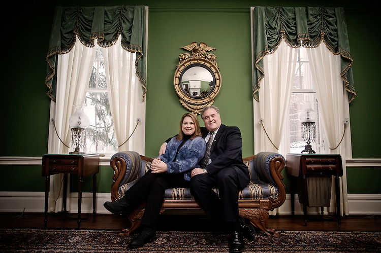 Graham and Tina Stewart pose for a portrait at Konneker Alumni Center.