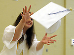 Brianna Wert catches her mortarboard  being tossed like a Frisbee from Charlette MacGregor, prior to the start of the Stafford High School graduation ceremony, Monday, June 24, 213, at the school in Stafford. (Jim Michaud / Journal Inquirer)