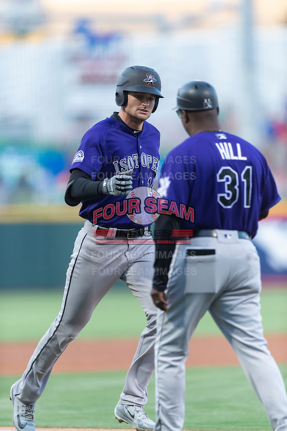 Albuquerque Isotopes right fielder Sam Hilliard (14) is congratulated by manager Glenallen Hill (31) after hitting a home run during a Pacific Coast League game against the El Paso Chihuahuas at Southwest University Park on May 10, 2019 in El Paso, Texas. Albuquerque defeated El Paso 2-1. (Zachary Lucy/Four Seam Images)