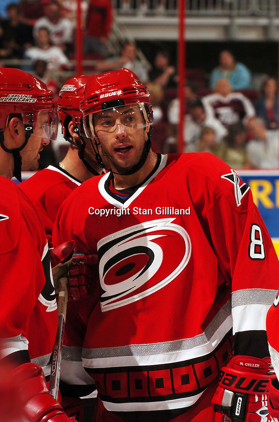 Carolina Hurricanes' Matt Cullen discusses things with teammates during a game with the Tampa Bay Lightning Thursday, Sep. 22, 2005 in Raleigh, NC. Carolina won 5-2.