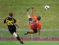 Waikato's Daniel Peat leaps for the ball..NZFC soccer  - Team Wellington v Waikato FC at Newtown Park, Wellington. Sunday, 20 December 2009. Photo: Dave Lintott/lintottphoto.co.nz