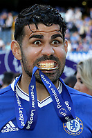 Diego Costa of Chelsea bites on his Premier League winners medal as he celebrates after the match during Chelsea vs Sunderland AFC, Premier League Football at Stamford Bridge on 21st May 2017