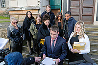 COPY BY TOM BEDFORD<br /> Pictured: Justin Chisnall (FRONT), reads a statement on behalf of the family of Shanice Clark (behind him wearing sunglasses) at the end of the inquest outside Newport Coroner's Court. Monday 26 February 2018<br /> Re: Inquest held at Newport Coroner's Court, into the death of five year old Ellie-May Clark who died of an asthma attack, after being refused a GP appointment in Newport, south Wales. <br /> Dr Joanne Rowe refused to see her, on the grounds that her mother was a few minutes late for a booked appointment.<br /> A few hours later, Ellie-May Clark suffered a seizure and died, despite the efforts of an ambulance crew.
