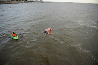 25/12/2013. A Diver jumps backwards from the tower in Blackrock Ireland during the Christmas Day Swim at Salthill, Galway