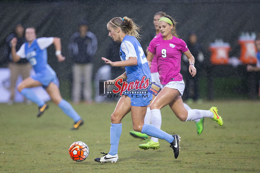 Cameron Castleberry (21) of the North Carolina Tar Heels pushes the ball up the field during first half action against the Wake Forest Demon Deacons at Spry Soccer Stadium on September 27, 2015 in Winston-Salem, North Carolina.  The Tar Heels defeated the Demon Deacons 1-0.  (Brian Westerholt/Sports On Film)