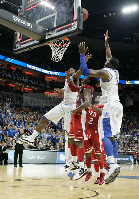 Players jump for the ball during the University of Kentucky versus  Western Kentucky University game in the second round of the NCAA Tournament, in the KFC Yum! Center, on Thursday, March 15, 2012 in Louisville, Ky.  Photo by Latara Appleby | Staff ..