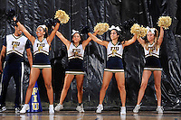 11 November 2011:  FIU cheerleaders fire up the crowd in the first half as the FIU Golden Panthers defeated the Jacksonville University Dolphins, 63-37, at the U.S. Century Bank Arena in Miami, Florida.