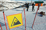 2/7/06 -- The 2006 Torino Winter Olympics -- Sestriere , Italy.Italian Alpine troups take a break at the top of the Slalom course in Sestriere Colle, Italy with a sign warning all passers by not to fall...Photo by Scott Sady, USA TODAY staff.