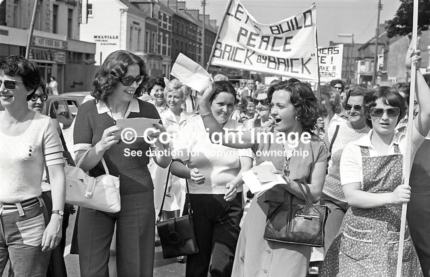 Betty Williams, left with white handbag, and Mairead Corrigan, right in plain dress, founders of the Peace People, lead a parade through Belfast, N Ireland, on their way to a rally in Ormeau Park on 21st August 1976. 197608210368a.<br /> <br /> Copyright Image from Victor Patterson, 54 Dorchester Park, Belfast, UK, BT9 6RJ<br /> <br /> t1: +44 28 9066 1296 (from Rep of Ireland 048 9066 1296)<br /> t2: +44 28 9002 2446 (from Rep of Ireland 048 9002 2446)<br /> m: +44 7802 353836<br /> <br /> e1: victorpatterson@me.com<br /> e2: victorpatterson@gmail.com<br /> <br /> www.victorpatterson.com<br /> <br /> IMPORTANT: Please see my Terms and Conditions of Use at www.victorpatterson.com