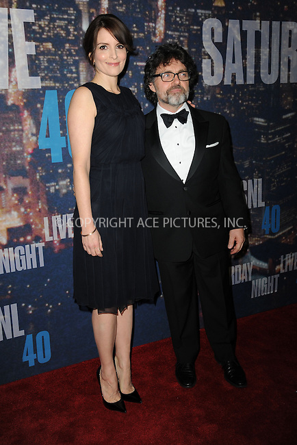 WWW.ACEPIXS.COM<br /> February 15, 2015 New York City<br /> <br /> Tina Fey and Jeff Richmond walking the red carpet at the SNL 40th Anniversary Special at 30 Rockefeller Plaza on February 15, 2015 in New York City.<br /> <br /> Please byline: Kristin Callahan/AcePictures<br /> <br /> ACEPIXS.COM<br /> <br /> Tel: (646) 769 0430<br /> e-mail: info@acepixs.com<br /> web: http://www.acepixs.com