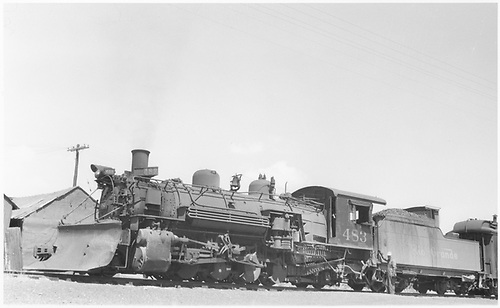 Fireman side view of K-36 #483 with plow in Dulce.<br /> D&amp;RGW  Dulce, NM  Taken by Peyton, Ernie S.