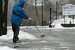 HARWINTON, CT - 7 January, 2009 -  010709MO04 - Torrington resident Travis Madden uses a broom to clear slush and ice from the end of a Church Street driveway Wednesday afternoon. Jim Moore Republican-American.