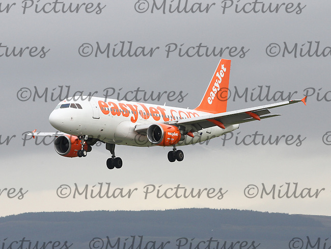An easyJet Airbus A319-111Registered Number G-EZBN landing from Amsterdam Schipol Airport at Glasgow Airport on 9.10.15.