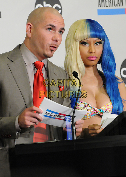 Pitbull (Armando Christian Perez) & Nicki Minaj.2011 American Music Awards Nominee Press Conference held at the JW Marriott LA Live Hotel, Los Angeles, California, USA..October 11th, 2011.half length top bra cleavage grey gray suit podium speech blue blonde hair dyed red tie.CAP/ADM/BP.©Byron Purvis/AdMedia/Capital Pictures.