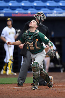 Siena Saints catcher Patrick Ortland (27) looks for a foul ball pop up in front of umpire Dorsey Hager during the second game of a doubleheader against the Michigan Wolverines on February 27, 2015 at Tradition Field in St. Lucie, Florida.  Michigan defeated Siena 6-0.  (Mike Janes/Four Seam Images)