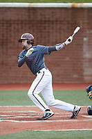 Chance Davis (18) of the Concord Mountain Lions follows through on his swing against the Wingate Bulldogs at Ron Christopher Stadium on February 1, 2020 in Wingate, North Carolina. The Bulldogs defeated the Mountain Lions 8-0 in game one of a doubleheader. (Brian Westerholt/Four Seam Images)