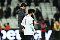 29th January 2020; London Stadium, London, England; English Premier League Football, West Ham United versus Liverpool; Liverpool Manager Jurgen Klopp speaks with Mohamed Salah at full time
